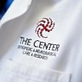 The Center Orthopedic & Neurosurgical Care logo